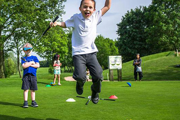 Junior golf lesson jump